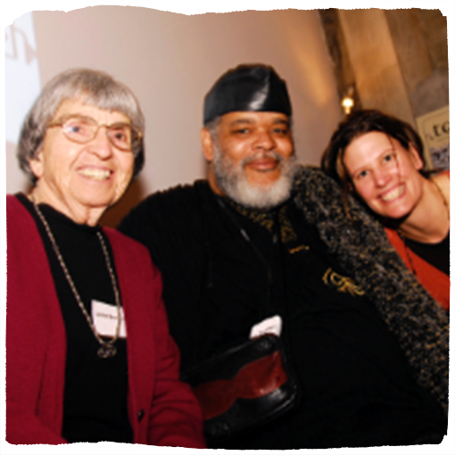 Seeding Justice co-founder Leslie Brockelbank and artist Bobby Fouther smile at the camera.
