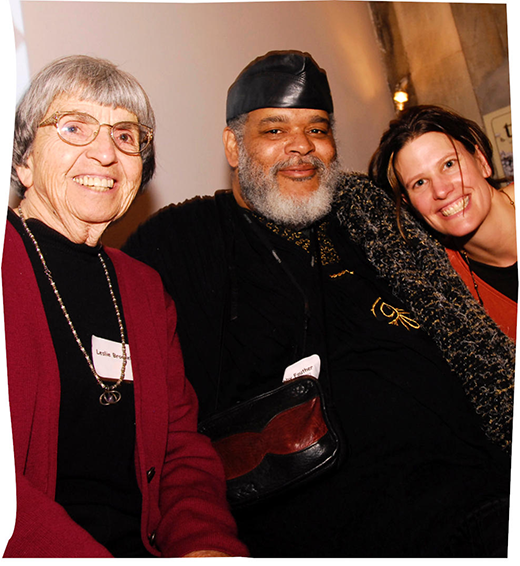 Seeding Justice co-founder Leslie Brockelbank, artist Bobby Fouther, and JWR volunteer Amy Doering Smith smile at the camera.